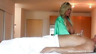 Blonde milf gives the best handjob massage to the fella