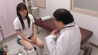 Long haired brunette gets fingered by the gynecologist